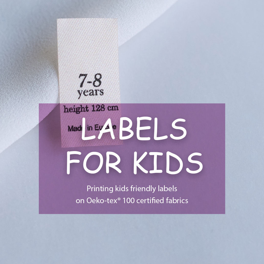 Compact label with a logo for children's clothes. Contains additional information (size, country of origin). 11